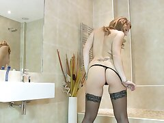 Horny solo MILF Ava Austen masturbates on the bathroom dazzle