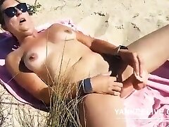 She's wanking on the seashore