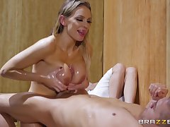 Oiled up MILF with a big ass Kenzie Taylor rides dick in a sauna