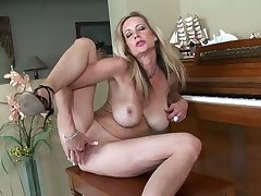 Spoiled alone busty nympho in high heels Cassy Torri pets her wet pussy