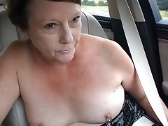 Exhibitionist MILF's Topless Car Escapade