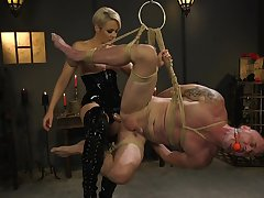 Dominant woman ass fucks male slave surrounding brutal BDSM
