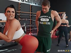 Sporty brunette of age Romi Rain gets fucked nearby the gym