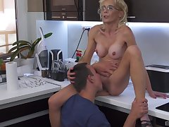 Anorexic mature blonde mixes dramatize with a young fella in the kitchen