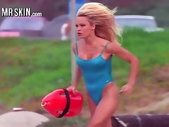 Gaffer baby Pamela Anderson working in her iconic red Baywatch swimsuit