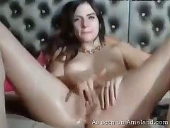 Webcam pamper masturbates her own shaved pussy so sincerely