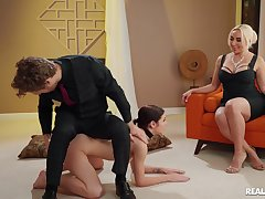 Sensual woman acts dominant with the Lilliputian drab