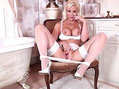 Handsome blonde mature Jennifer Jade takes off her white panties